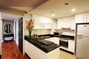 The kitchen comes with a large refrigerator, own, microwave and cooking stoves