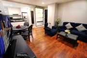 The living room provides ample space for the whole family and comes with a large flat screen LCD television
