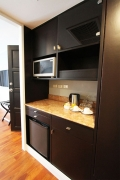 The pantry comes with a microwave oven, cups, plates, water kettle and a mini-bar refrigerator.